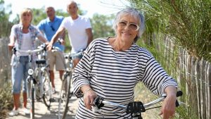 Middle-aged people on bike ride looking healthy and happy